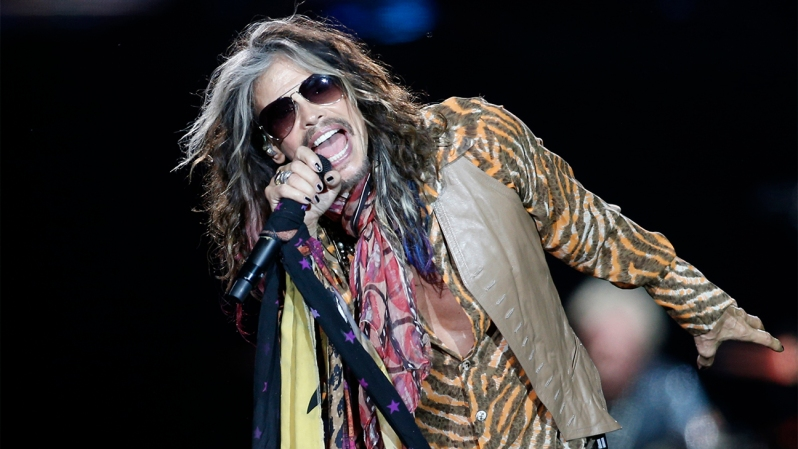 Steven Tyler of the American rock band Aerosmith performs on stage during their Global Warming World Tour concert in Vilnius, Lithuania, Wednesday, May 21, 2014. (AP Photo/Mindaugas Kulbis)